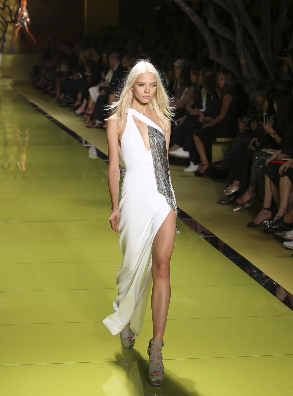 A model wears a creation for Versace's women's Spring-Summer 2014 collection, part of the Milan Fashion Week, unveiled in Milan, Italy, Friday, Sept. 20, 2013. (AP Photo/Antonio Calanni)