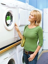 woman shopping for energy-efficient appliances