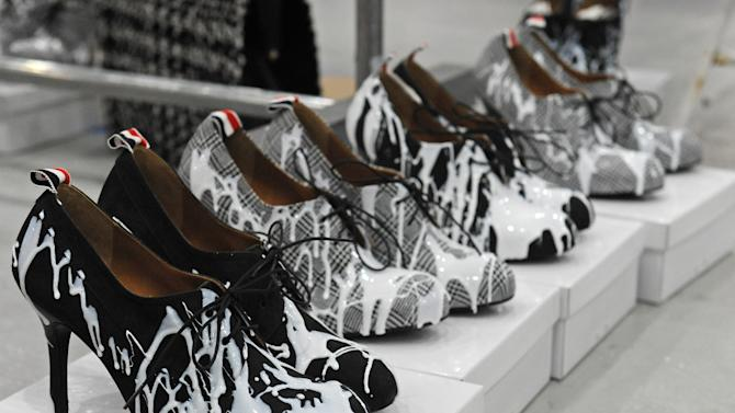 FILE - This Feb. 11, 2013 file photo shows shoes to be worn by models displayed backstage before the showing of the Thom Browne Fall 2013 collection during Fashion Week in New York. As New York Fashion Week's fall previews wrapped up Thursday, designers didn't ignore the feet.  (AP Photo/Louis Lanzano, file)