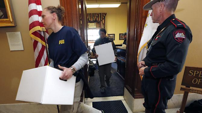 FILE-- In this March 21, 2014 photograph, FBI investigators leave the office of Rhode island House Speaker Gordon Fox at the Statehouse in Providence. The most expensive governor's race in Rhode Island history and a Statehouse raid that led to the fall from power of Fox topped the news in Rhode Island in 2014. (AP Photo/Michael Dwyer, File)