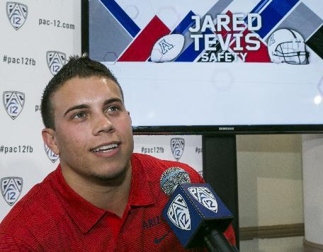 Arizona safety Jared Tevisis interviewed at the 2014 Pac-12 NCAA college football media days at Paramount Studios in Los Angeles Wednesday, July 23, 2014. (AP Photo)
