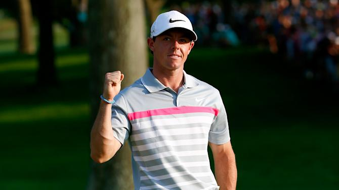 Rory McIlroy of Northern Ireland celebrates his winning putt on the 18th green during the final round of the World Golf Championships-Bridgestone Invitational at Firestone Country Club South Course on August 3, 2014 in Akron, Ohio