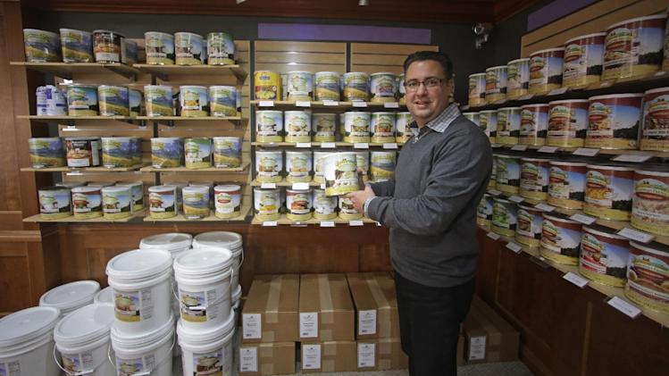 In this Dec. 11, 2013, photo, Paul Fulton, president of Ready Store, poses next to dehydrated food products in his showroom at his store, in Draper, Utah, about 20 miles south of Salt Lake City. In Utah, storing away enough food and water in case of disaster, job loss or something worse is not just part of the fundamental teachings of The Church of Jesus Christ of Latter-day Saints, it's an idea that is increasingly catching on nationwide. And it's also big business. (AP Photo/Rick Bowmer)