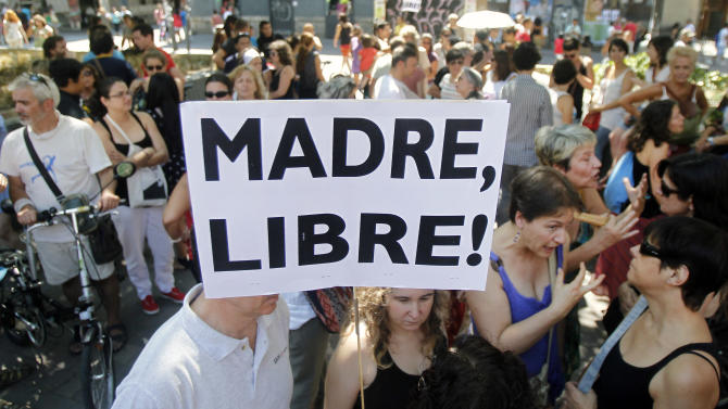 "A protester shows a banner that reads: ""Free Mother"" during a protest against abortion law reform in Madrid, Spain, Sunday, July 29, 2012. (AP Photo/Andres Kudacki)"