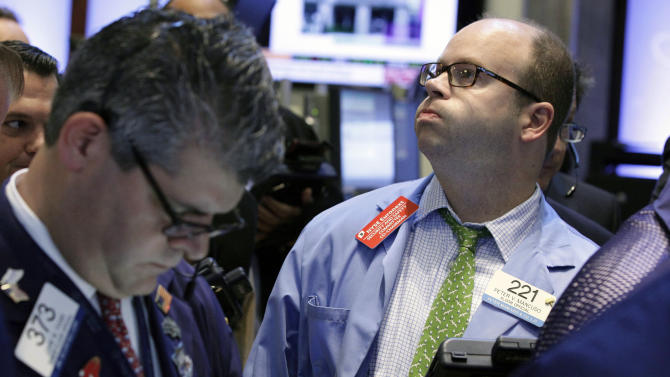 Trader Peter Mancuso, right, works on the floor of the New York Stock Exchange Thursday, Sept. 20, 2012. A batch of worrying economic figures tugged stock markets slightly lower Thursday. Measures of manufacturing and business activity in both China and Europe slumped.  (AP Photo/Richard Drew)