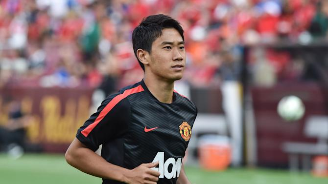 Manchester United's Shinji Kagawa smiles at fans before a Champions Cup match against Inter Milan at FedEx Field in Landover, Maryland, on July 29, 2014