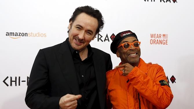 "Actor John Cusack and Spike Lee pose on the red carpet at the premiere of ""Chi-Raq"" in New York"