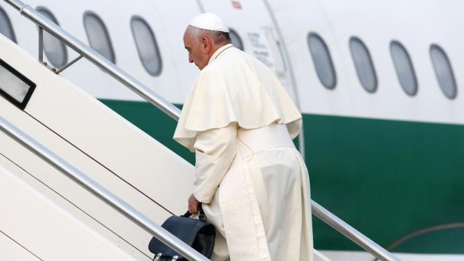 Pope Francis boards his plane at Fiumicino airport in Rome