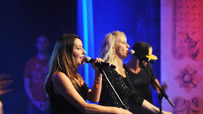 Keren Woodward, on left, and Sara Dallin of Bananarama perform at the 13th Annual Pinktober Breast Cancer Awareness Campaign, on Tuesday, Oct. 2, 2012 at Hard Rock Cafe, New York. (Photo by Scott Gries/Invision for Hard Rock/AP Images)