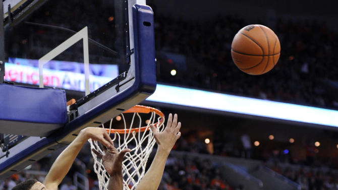Syracuse's Michael Carter-Williams (1) battles for the ball with Georgetown's Moses Ayegba (32) during the first half of an NCAA college basketball game, Saturday, March 9, 2013, in Washington. (AP Photo/Nick Wass)