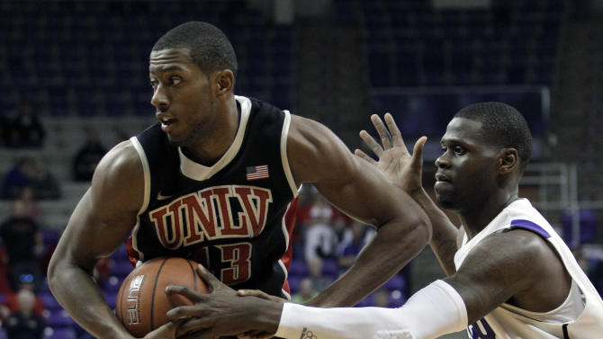 UNLV 's Mike Moser (43) controls the ball ahead of TCU's J.R. Cadot, right, in the first half of an NCAA college basketball game Tuesday, Feb. 14, 2012, in Fort Worth, Texas. (AP Photo/Tony Gutierrez)