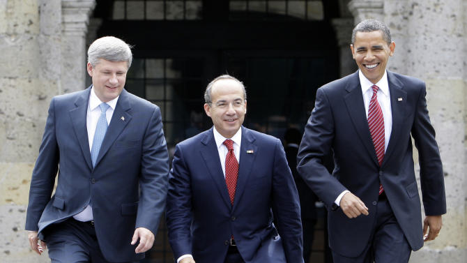 FILE - In this Aug. 10, 2009, file photo, President Barack Obama, right, Mexico's President Felipe Calderon, center, and Canada's Prime Minister Stephen Harper walk towards a stand for an official photo in Guadalajara, Mexico, for a North American summit. Obama is convening a summit with leaders from Mexico and Canada on Monday, April 2, 2012, that aims to boost a fragile recovery and grapple with thorny energy issues against a backdrop of painfully high gas prices. The session at the White House is a make-good for a planned meeting last November in Hawaii on the sidelines of the Asia-Pacific summit. Obama ended up meeting just with Harper when Mexican President Felipe Calderon's top deputy was killed in a helicopter crash. (AP Photo/Alex Brandon, File)