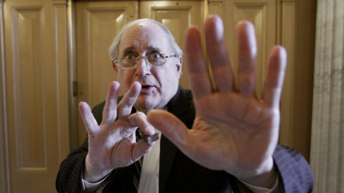 Sen. Carl Levin, D-Mich., jokes with a photographer near the floor of the Senate before the votes on tax cuts legislation on Capitol Hill in Washington Wednesday, Dec. 15, 2010.(AP Photo)