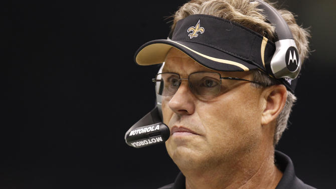FILE - In this Sept. 26, 2010, file photo, Saints defensive coordinator Gregg Williams looks on during an NFL football game against the Atlanta Falcons at the Louisiana Superdome in New Orleans. The NFL has suspended New Orleans head coach Sean Payton for the 2012 season, and former Saints defensive coordinator Gregg Williams is banned from the league indefinitely because of the team's bounty program that targeted opposing players. Also Wednesday, March 21, 2012, Goodell suspended Saints general manager Mickey Loomis for the first eight regular-season games of 2012, and assistant coach Joe Vitt has to sit out the first six games. (AP Photo/Gerald Herbert, File)