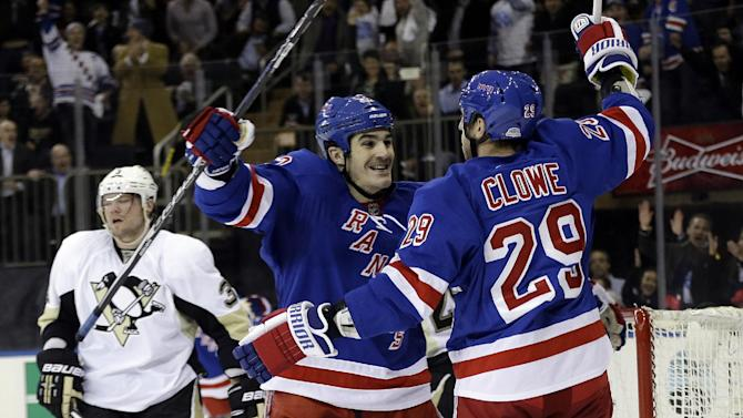 Pittsburgh Penguins' Douglas Murray (3) reacts as New York Rangers' Brian Boyle, center, hugs Ryane Clowe (29) after Clowe scored his second goal of the game during the first period of an NHL hockey game, Wednesday, April 3, 2013, in New York. (AP Photo/Frank Franklin II)