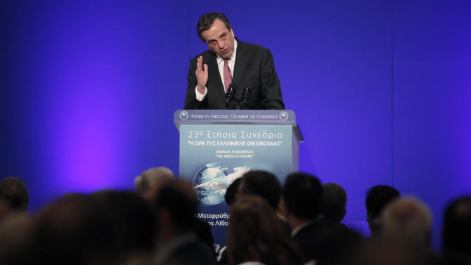 Greece's Prime Minister Antonis Samaras speaks about the Greek economy at the annual conference of the American-Hellenic Chamber of Commerce in Athens, Tuesday, Dec. 4, 2012. Greece is planning to spend up to euro 10 billion ($13 billion) in a bond buyback program that it hopes will help bring its debt under control. (AP Photo/Petros Giannakouris)