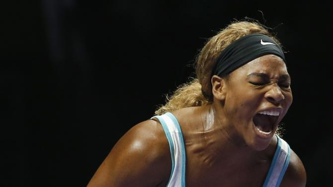 Serena Williams of the U.S. shouts as she wins a point against Caroline Wozniacki of Denmark during their WTA Finals singles semi-finals tennis match at the Singapore Indoor Stadium