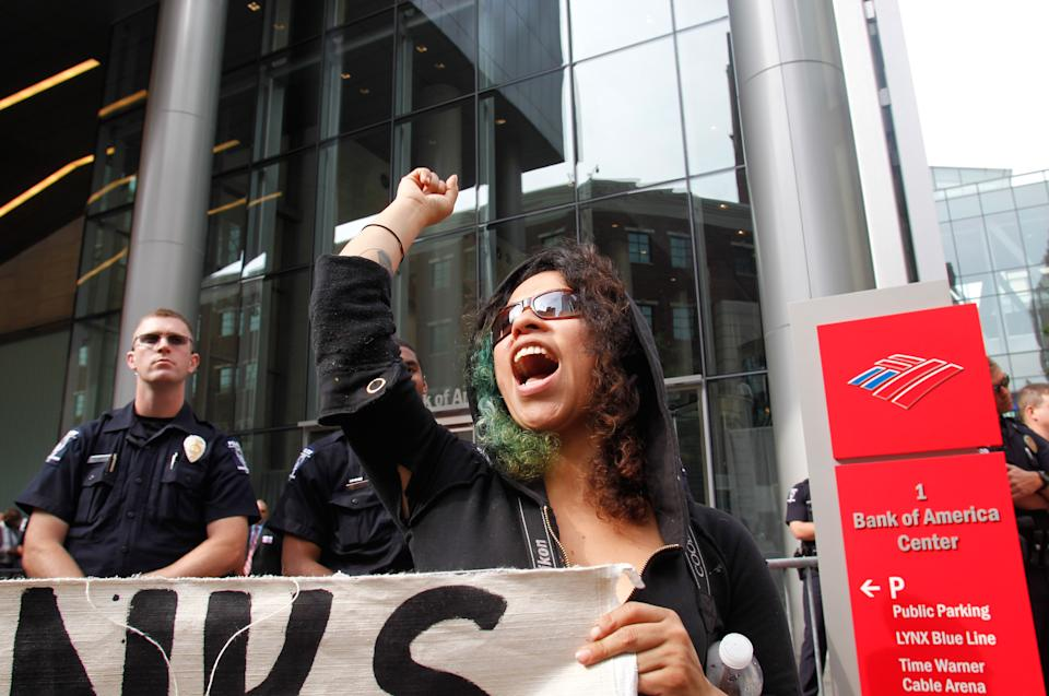 Charlotte-Mecklenburg Police stand at the entrance of the Bank of America's shareholder meeting as protesters try to cause a disruption to the annual meeting, Wednesday May 9, 2012, in Charlotte, N.C. (AP Photo/Bob Leverone)