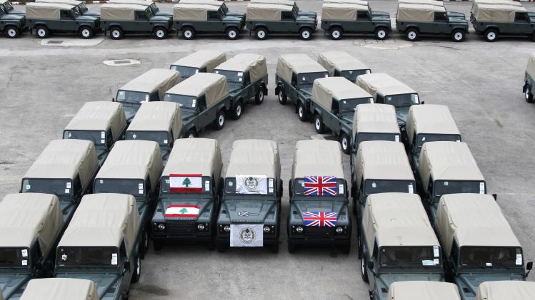 Lebanese and British national flags are seen on the military vehicles that were given as aid to the Lebanese army in Kfarshima