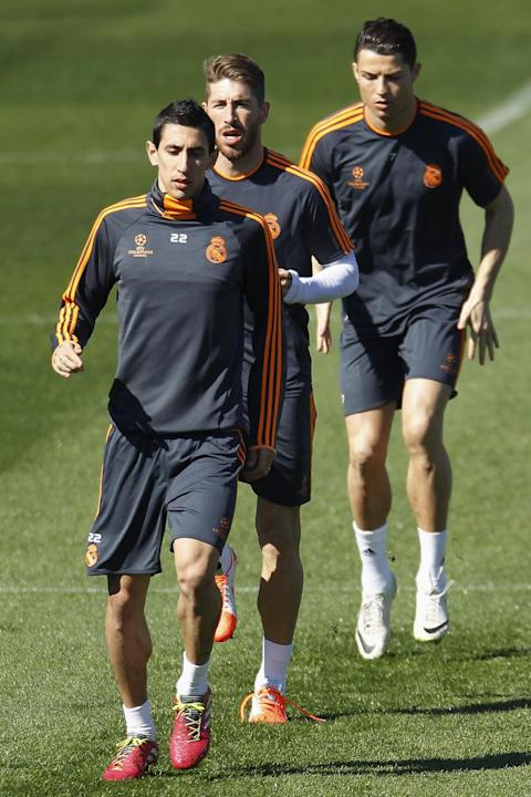 Real's Cristiano Ronaldo from Portugal, right, Angel Di Maria from Argentina, left, and Sergio Ramos, center, exercise during a training session in Madrid, Spain, Monday March 17, 2014, ahead of t