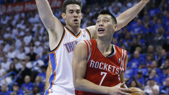 Houston Rockets guard Jeremy Lin (7) drives past Oklahoma City Thunder forward Nick Collison (4) in the second quarter of Game 2 of their first-round NBA basketball playoff series in Oklahoma City, Wednesday, April 24, 2013. (AP Photo/Sue Ogrocki)