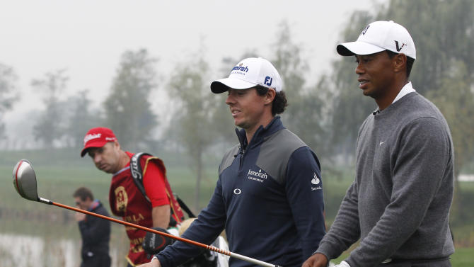 Tiger Woods of the United States, right, and Rory McIlroy of Northern Ireland walk together during their 18-hole medal-match at the Lake Jinsha Golf Club in Zhengzhou, in central China's Henan province, Monday, Oct. 29, 2012. (AP Photo/Alexander F. Yuan)
