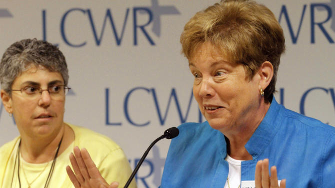 Sister Donna Markham, right, speaks to reporters while Sister Mary Pellegrino looks on during the Leadership Conference of Women Religious'(LCWR) assembly Thursday, Aug. 9, 2012 in St. Louis. The LCWR, the largest U.S. group for Roman Catholic nuns, are meeting to decide how they should respond to a Vatican rebuke and order for reform. The LCWR represents about 80 percent of the 57,000 U.S. sisters. (AP Photo/Seth Perlman)