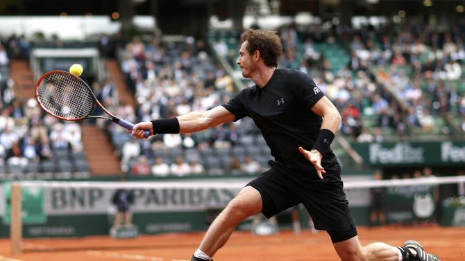 Andy Murray of Britain plays a shot to Joao Sousa of Portugal during their men's singles match at the French Open tennis tournament at the Roland Garros stadium in Paris