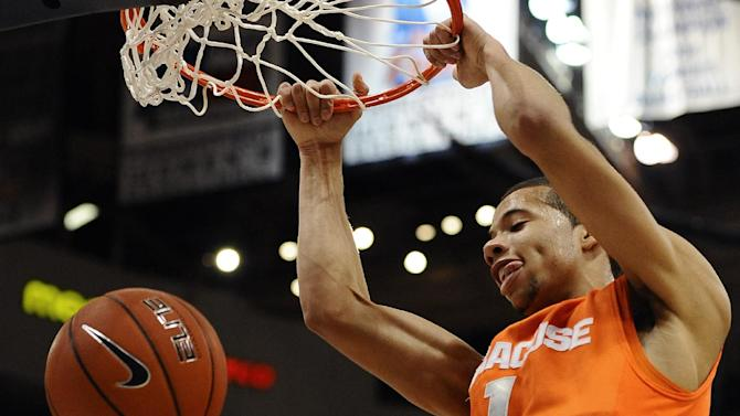 Syracuse's Michael Carter-Williams dunks the ball during the first half of an NCAA college basketball game against Connecticut in Hartford, Conn., Wednesday, Feb. 13, 2013. (AP Photo/Jessica Hill)