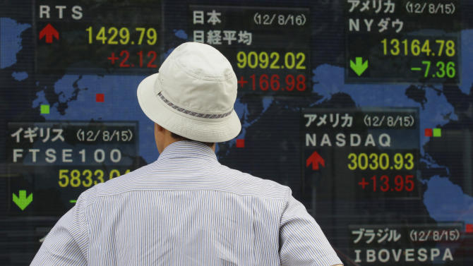 A man looks at a securities firm's electronic stock board in Tokyo Thursday, Aug. 16, 2012. Japan's Nikkei 225 index rose 1.88 percent to 9,092.76 Thursday as Asian stock markets were mostly higher after comments from Chinese Premier Wen Jiabao added to hopes for more action to spur the world's No. 2 economy. (AP Photo/Shizuo Kambayashi)