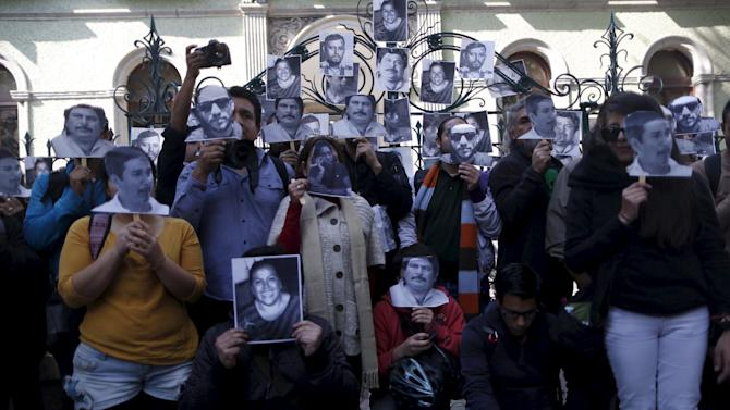 Journalists and activists hold images of murdered journalists during a demonstration against the murder of a journalist Anabel Flores outside the Government of Veracruz building in Mexico City
