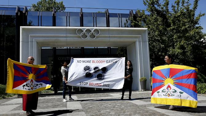 Tibetan monk Jigme and members of the Tibetan Youth Association in Europe protest against the designation of Beijing for the Winter Olympics Games 2022 in front of the IOC in Lausanne