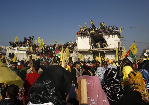 Palestinians wave yellow Fatah flags during celebrations marking the 48th anniversary of the Fatah movement in Gaza City, Friday, Jan. 4, 2013. The secular-leaning Fatah party staged a massive rally Friday in the Gaza Strip, the first such gathering in the territory since the Islamist Hamas group violently took control there in 2007 - a reflection of the warming ties between the two rival Palestinian factions.(AP Photo/Hatem Moussa)