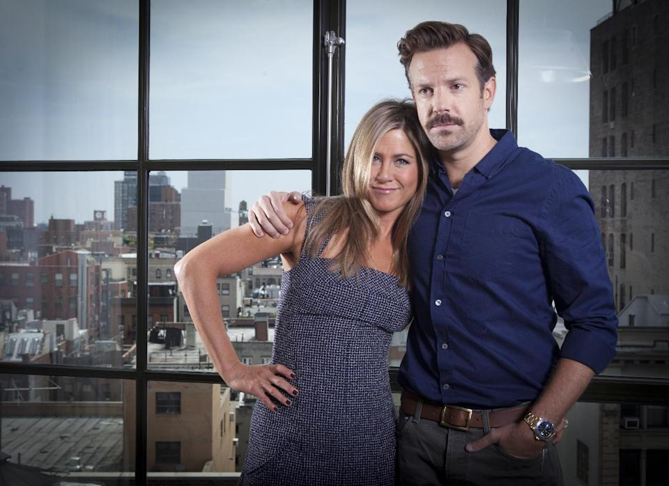 "Actor Jason Sudeikis and actress Jennifer Aniston pose for a portrait as they promote the movie ""We're the Millers"" in New York, July, 27, 2012 in New York. (Photo by Carlo Allegri/Invision/AP Images)"