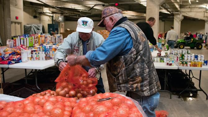 FILE - In this  Friday, Sept. 21, 2012, file photo, Karl Hock, left, and Duane Varner unload onions for the food distribution at the Food Bank of Eastern Michigan, in Midland, Mich.  A second month of sharp gains in gasoline costs drove wholesale prices higher in September. But outside of the surge in energy, prices were well contained. Wholesale prices rose 1.1 percent in September following 1.7 percent gain in August which had been the largest one-month gain in more than three years, the Labor Department said Friday, Oct. 12, 2012. (AP Photo/The Bay City Times, Yfat Yossifor) LOCAL TV OUT; LOCAL INTERNET OUT