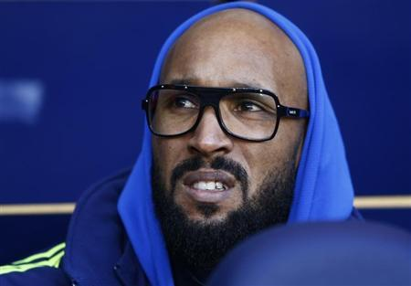 West Bromwich Albion's Anelka watches from the bench during their English Premier League soccer match against Tottenham Hotspur in London
