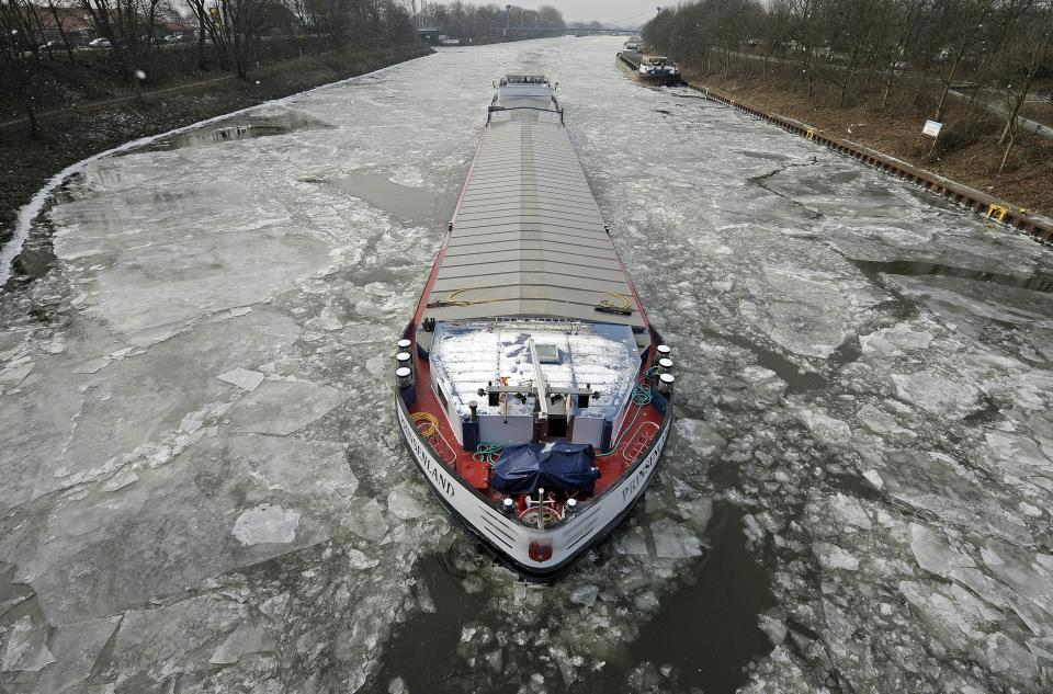 A transport ship makes its way through the ice on the Rhine-Herne canal in Gelsenkirchen, Germany, Tuesday, Feb. 7, 2012. Many canals and rivers in Germany are closed because of the ice. (AP Photo/Martin Meissner)