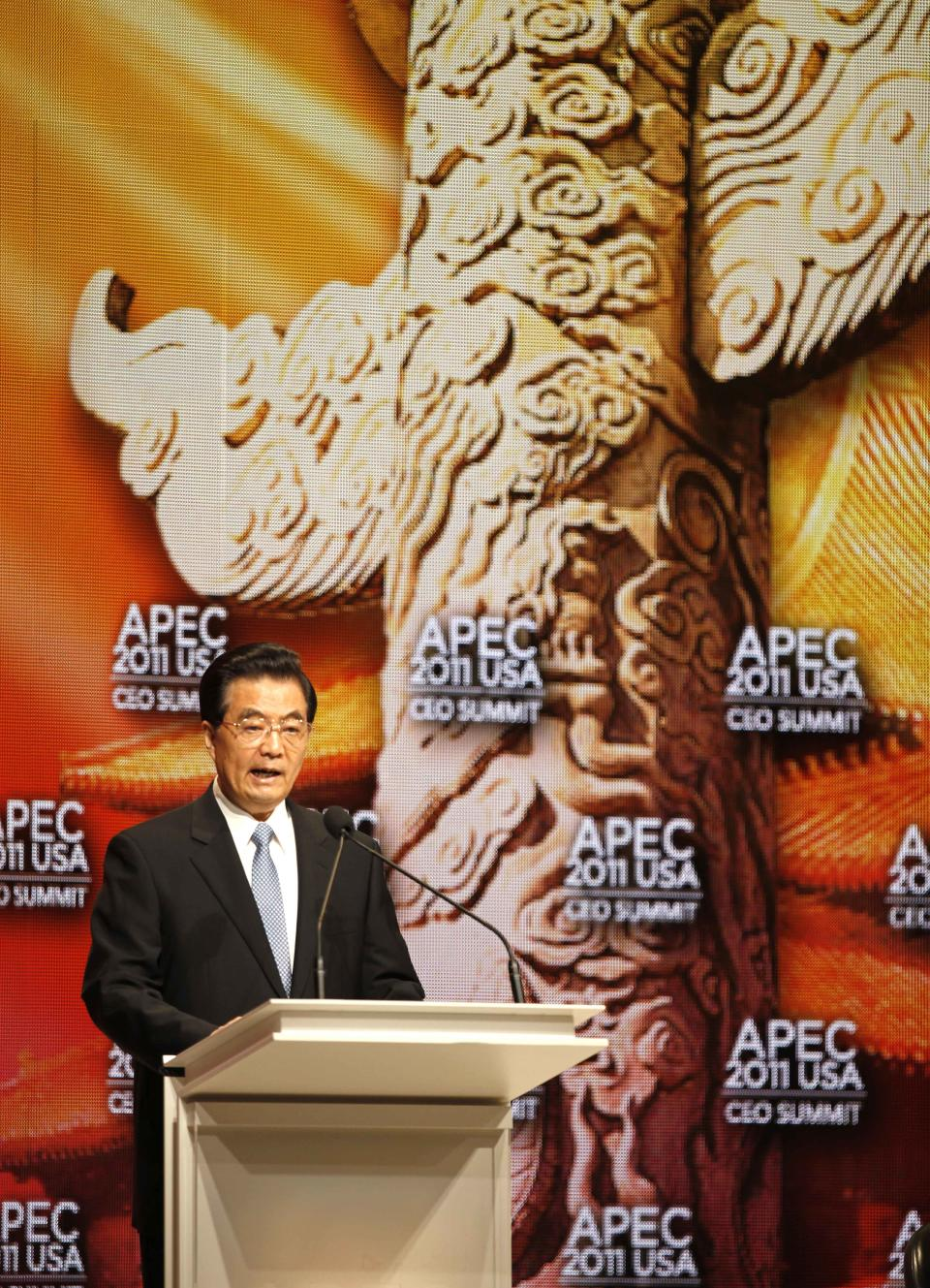 Chinese President Hu Jintao addresses the APEC CEO Summit, a gathering of business leaders at the Asia-Pacific Economic Cooperation summit Saturday, Nov. 12, 2011, in Honolulu. (AP Photo/Andres Leighton)