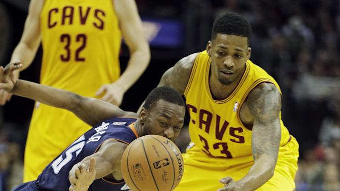Bobcats clinch playoffs in 96-94 OT win over Cavs