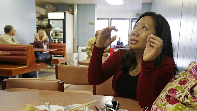 In this Thursday, Sept. 20, 2012 photo, Patricia Tin eats lunch at Ma Hnin Burmese-Thai restaurant in Fort Wayne, Ind. Tin, who works at a bank, is also attending college to become a teacher. Fort Wayne, home to one of the United States' largest Burmese populations, has become an unlikely base for opposition to the country's former military regime.  (AP Photo/Darron Cummings)