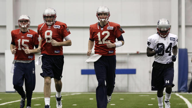 New England Patriots quarterback Tom Brady (12) runs with Ryan Mallett (15), Brian Hoyer (8), and Deion Branch (84) during practice on Thursday, Feb. 2, 2012, in Indianapolis. The Patriots are scheduled to face the New York Giants in NFL football Super Bowl XLVI on Feb. 5. (AP Photo/Mark Humphrey)