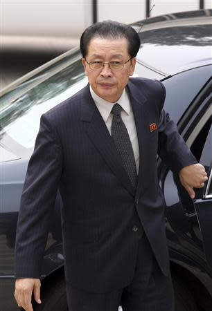 File photo of Jang Song Thaek arriving at Ziguangge building in Beijing