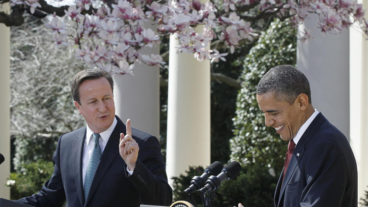 President Barack Obama laughs as British Prime Minister David Cameron makes opening remarks during their joint news conference in the Rose Garden of the White House in Washington, Wednesday, March 14, 2012. (AP Photo/Charles Dharapak)