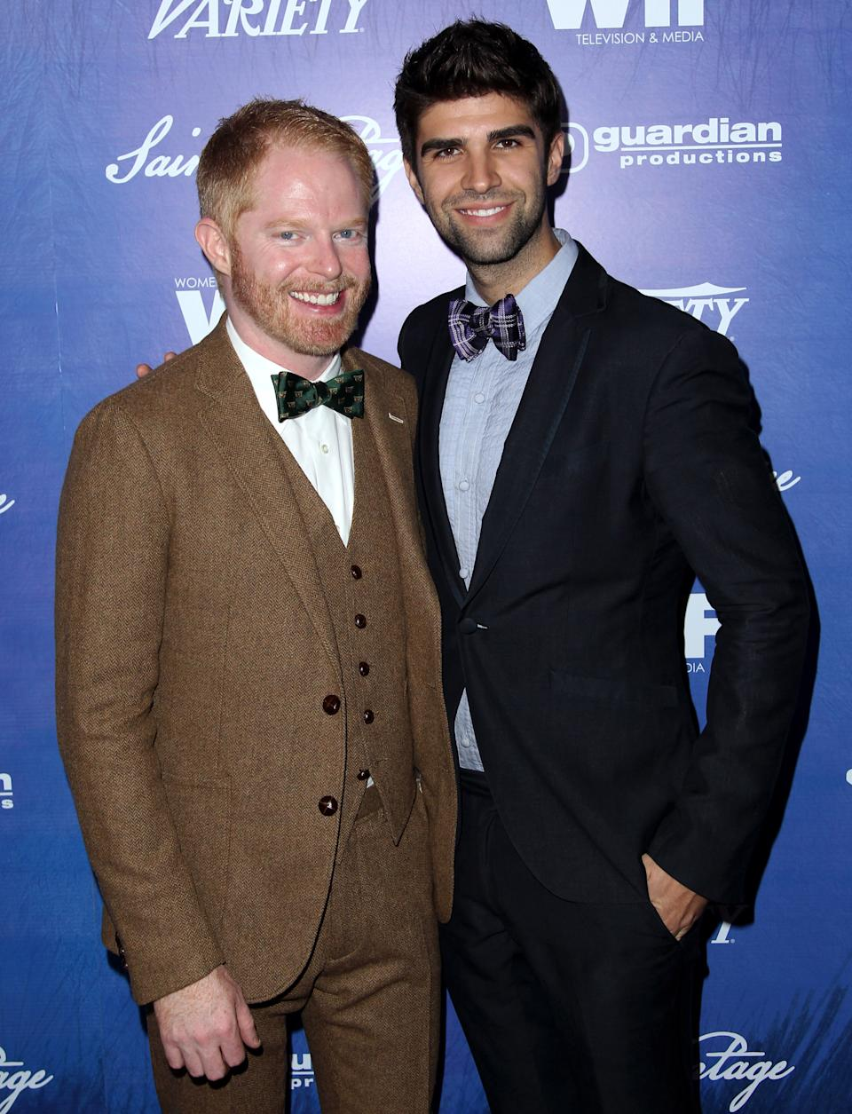 Jesse Tyler Ferguson, left, and Justin Mikita attend the Variety and Women in Film Pre-Emmy Event at Scarpetta on Friday, Sept. 21, 2012, in Beverly Hills, Calif. (Photo by Matt Sayles/Invision/AP)
