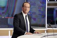 French President Francois Hollande appears on the French TV channel TF1. Hollande has pledged 30 billion euros in new taxes and savings to balance the budget and fund a turnaround in two years and rejected criticism of dragging his feet