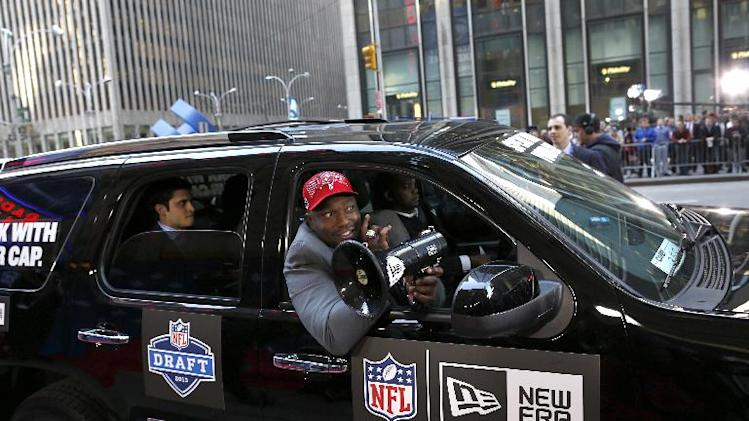 IMAGE DISTRIBUTED FOR NEW ERA CAP - NFL Network host and newly elected Pro Football Hall of Famer Warren Sapp arrives as fans and media await the official 2013 New Era NFL Draft Caps delivery to Radio City Music Hall, on Thursday April 25, 2013. (John Minchillo/AP Images for New Era Cap)
