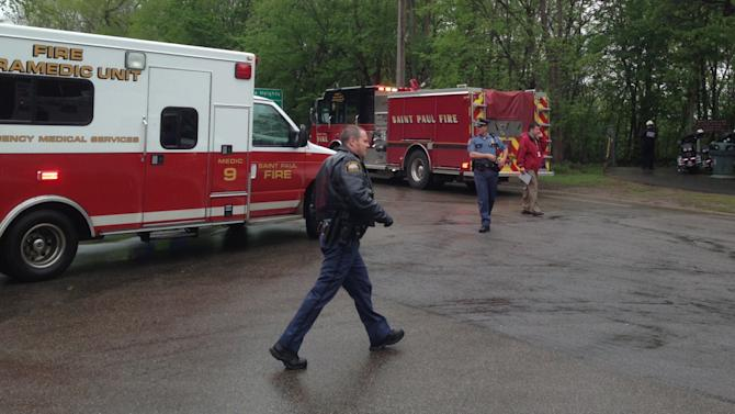 Police and fire department officials respond to the scene of a rockslide at Lilydale Regional Park Wednesday, May 22, 2013 in St Paul. Minn. Officials say one child is dead and another is unaccounted for after a gravel slide in the St. Paul park. (AP Photo/Star Tribune, Jerry Holt)