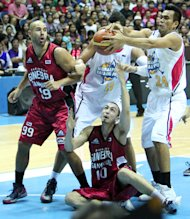 A scramble for the looseball. (PBA Images)