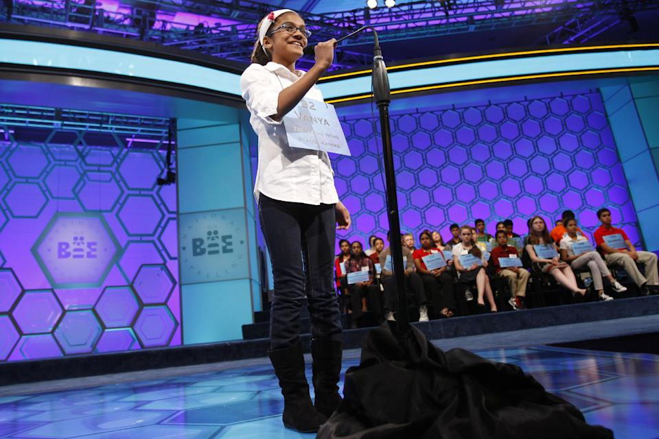 Vanya Shivashankar, 10, of Olathe, Kansas, spells a word during the semifinals of the National Spelling Bee in Oxon Hill, Md., Thursday, May 31, 2012.  (AP Photo/Jacquelyn Martin)