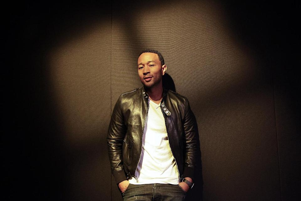 "In this Thursday, Aug. 29, 2013 photo, singer John Legend poses for photos after an interview, in Los Angeles. Legend's fourth album, ""Love In The Future,"" went on sale on Sept. 3, 2013. (AP Photo/Jae C. Hong)"